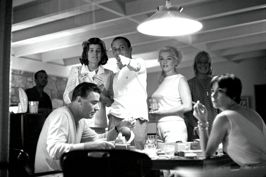 frank-sinatra-patricia-kennedy-lawford-marilyn-monroe-and-peter-lawford-play-with-a-new-polaroid-camera-may-britt-is-in-background-photo-by-bernie-abramson